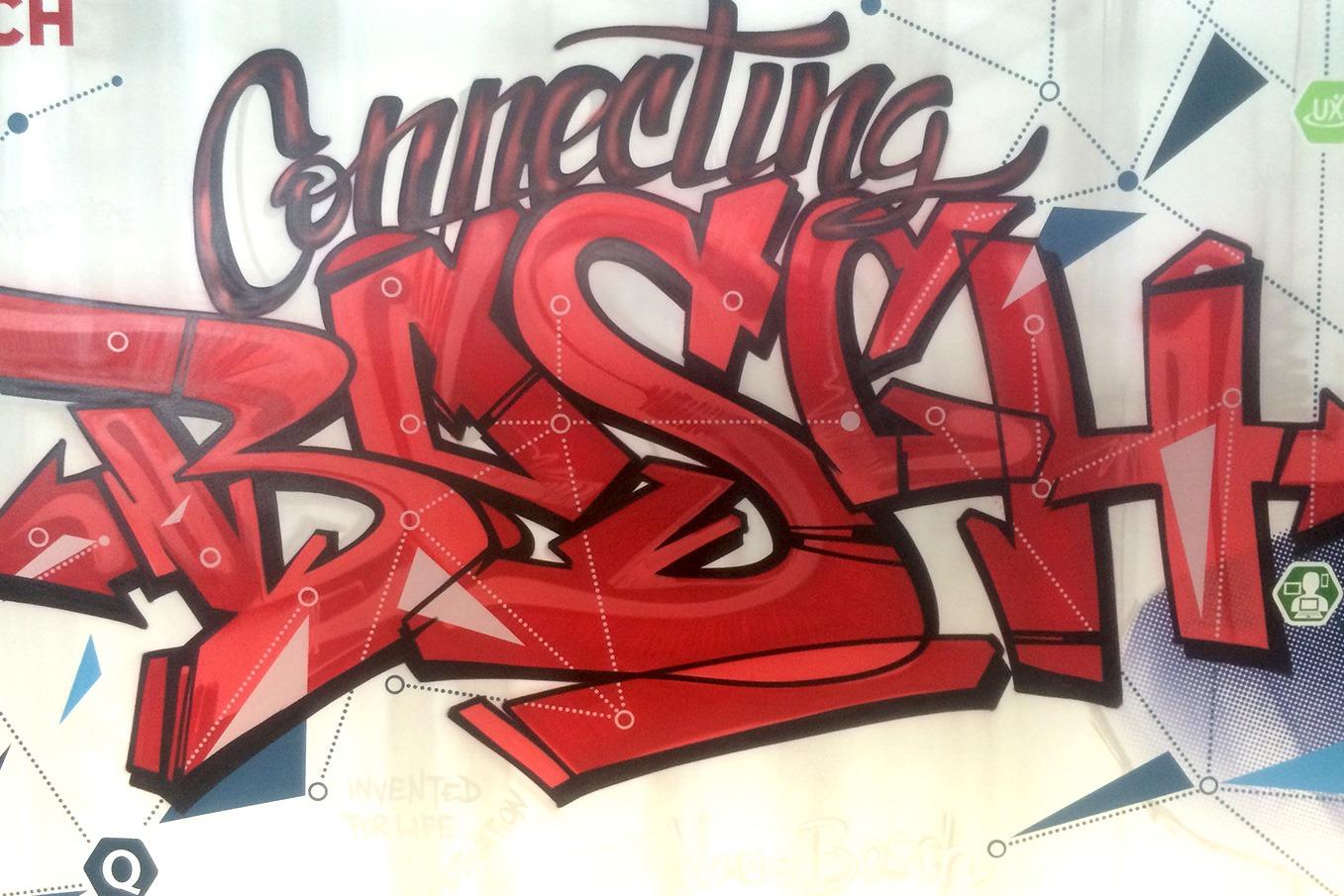 graffitiauftrag-graffitikuenstler-artmos4-Bosch_2015_graffiti_schrift_grafisch_menschen_innen_rot_grau_Illustrativ_Technik