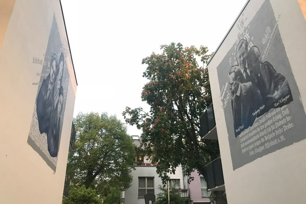 graffitiauftrag-graffitikuenstler-artmos4-baugenossenschaft-odenwaldring-2012-skyline-landschaft-aussen-gebaeude-bunt-kunst