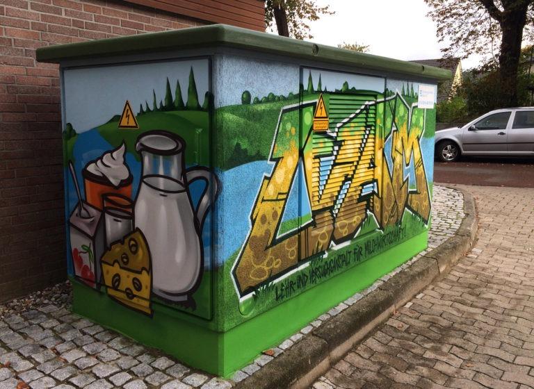 Graffitikuenstler, Graffitiauftrag, Artmos4, Hansewerke, Milch, Schrift, Comic