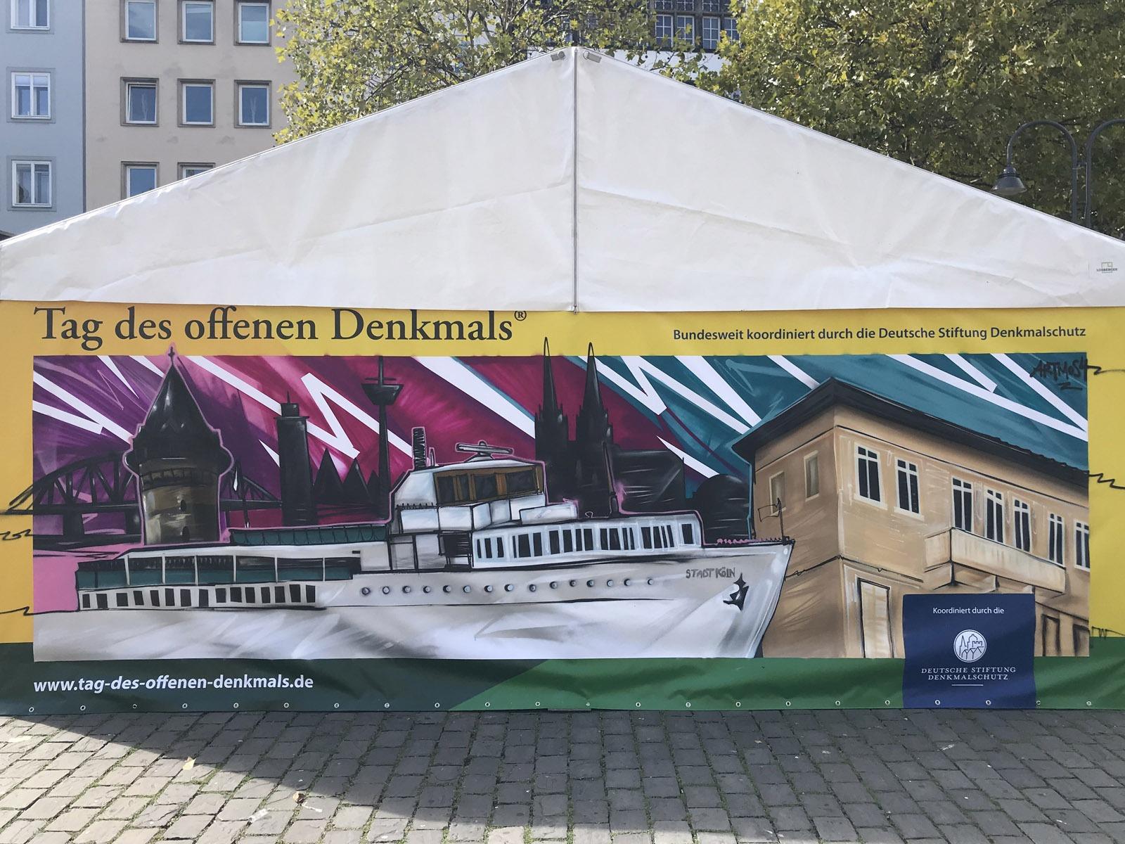 graffitiauftrag_graffitikuenstler_artmos4_Tag_des_Denkmals_Köln_beeffective_2018_trashig_schiff_skyline_bunt