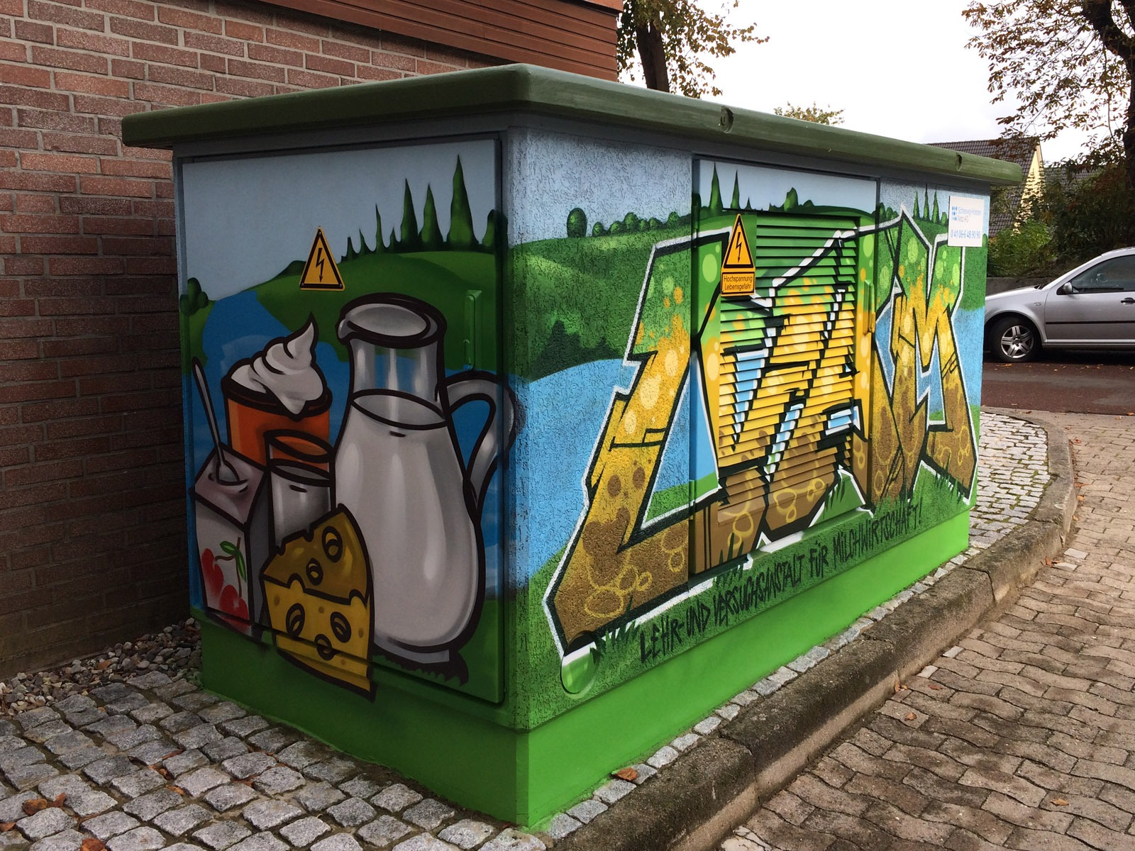 graffitiauftrag-graffitikuenstler-hansewerk-2016-graffiti-essen-landschaft-gruen-bunt-comic-aussen-energieversorger